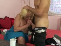 Blonde spreads her hairy old pussy for him