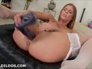 Hot babe in white stockings fucking her pussy with a big purple dildo in HD