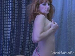 Mature redhead is proud of her naked body