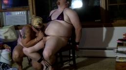 Bound Feminized sissy in bikini sucks strapon & drinks cum from shot glass