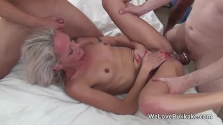 Small framed blonde used as a fuck and cum toy for a group of men