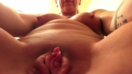 Mature Plays with Shaved Pussy