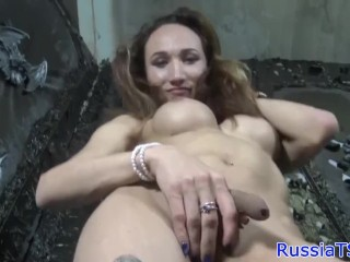 Busty russian tgirl uses dildo while jerking