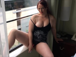 Redhead gets off in friends condo while neighbors watch