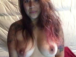 Dirty talking lesbian with natural tits