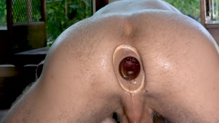 Massive Gape with a tunnel plug in front of a window