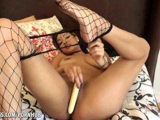 Gabriella Lane uses a cream-colored toy