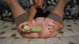 The girl fucked her pussy with a large zucchini