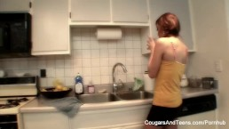 Busty MILF teaches young brunette how to cook and more