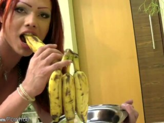 Charming redhead shedoll licks her round tits and banana too