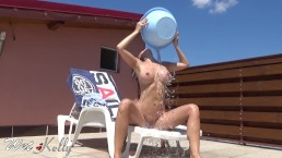 Surprising my neighbor voyeur with hot tan masturbation and cold water play