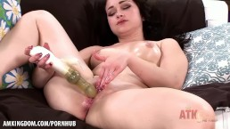 Black haired hottie fucks herself with toy