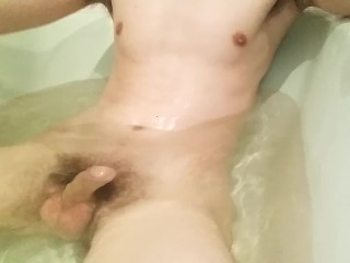 naked boy in bathroom.water.
