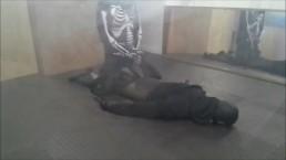 skeleton wearing a wetsuit