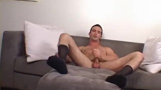 A tall hunk is jerking his cut cock while playing with socks Handsome serviced