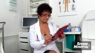 A patient receives a handjob from a dirty MILF doctor Marta