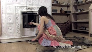Maia masturbates and orgasms by the fire