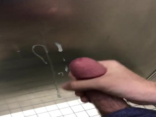 Teen spunks on stall wall in bathroom