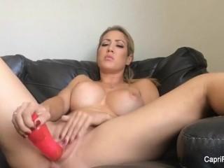 Horny Capri Cavanni puts a big dildo in her pussy