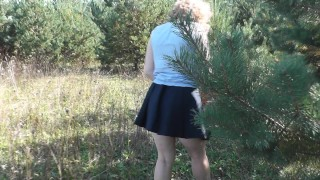 Skirt naked under in woods without panties under closeup