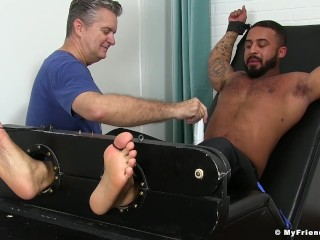 Picture of Damian Taylor is bound to the torture bed and gets tickled