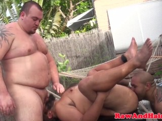 Chubby bear wanks cum in bare spitroast trio