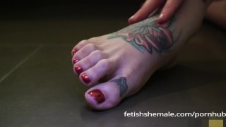 Jenna Tales Shows off her Sexy Shemale Feet Transsexual tits