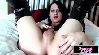 Gothic femboy toying with anal beads
