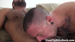 Tattooed stud bareback fucked by a bear