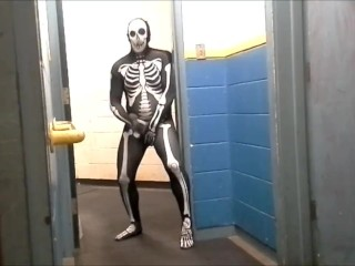 skeleton with hard on jerks off in gym hall