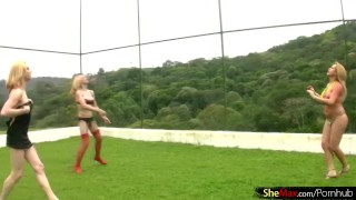 Four blonde chicks with dicks play volleyball and strip down