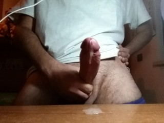 Horny guy cumming and moaning while masturbating