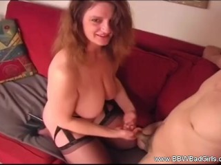 Redhead BBW Handjob On The Couch