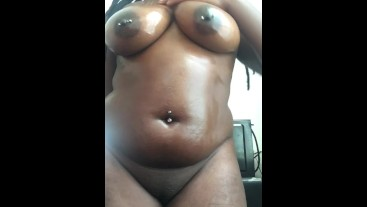 Black babe oils ass and tits