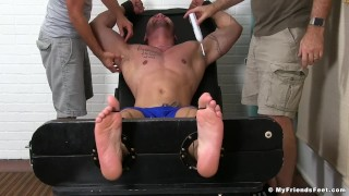 Julian Knowles is restrained and tickled by two kinky studs Girl double
