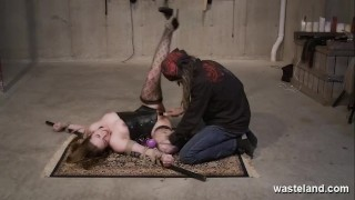 BDSM Floor Workout. Pretty female submissive bound on the floor and caned.