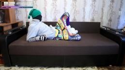 Encased in sweatpants and hoodie in long tube slipper socks