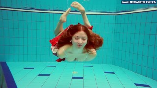 Hot Polish redhead swimming in the pool