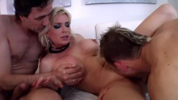 Huge titted babe Diamond Fox busy pleasuring two cocks