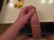 Playing with my huge cock stretching out a Magnum