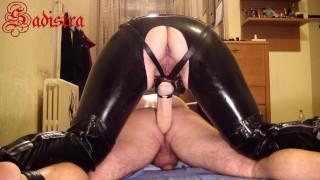 Latex Mistress Sadistra whipping & fucking slave's asshole