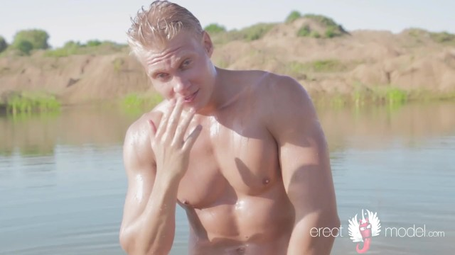 Gay erect penis pictures Blonde muscle guy masturbating his wet cock in the lake water