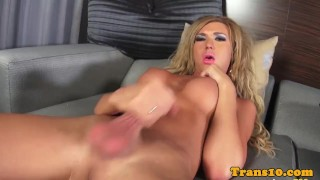 Bigtitted lingerie tgirl tugs cock on couch