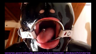 Shiny black latex slut ring gagged hogtied & unmercifully skullfucked INTRO  ring gag blowjob brutal skull fuck hard bondage fuck ring gag cumshot spiel maschinerie black latex bdsm kink throated rough latex latex mask ring gag facefuck throat fuck latex hard fuck ring gag deepthroat