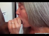 Grey haired honey gets fucked by black in the kitchen