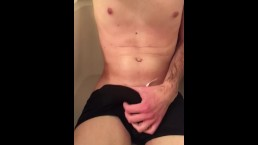 Twink strokes his thick cock and cums in Speedo