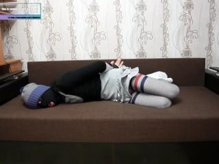 Encasement bondage in skirt hoodie in slipper socks