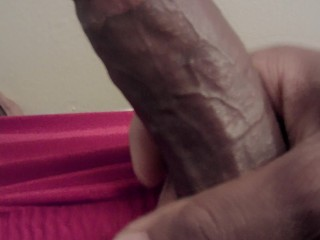 Black dick jerking it hard, busts a load
