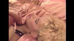 Peter North decorates a hot blondes face with jizz