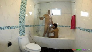 Wife showers with hubby and gives him a blowjob